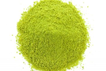 dry tea powder on white background